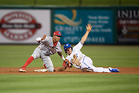 Clearwater Threshers second baseman Daniel Brito (21) attempts to tag Ryan Noda (19) on a stolen base during a Florida State League game against the Dunedin Blue Jays on April 4, 2019 at Spectrum Field in Clearwater, Florida.  Dunedin defeated Clearwater 11-1.  (Mike Janes/Four Seam Images)