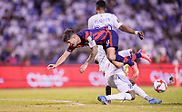SAN PEDRO SULA, HONDURAS - SEPTEMBER 8: Christian Pulisic #10 of the United States moves towards the goal and is tripped up by Maynor Figueroa #3 of Honduras during a game between Honduras and USMNT at Estadio Olímpico Metropolitano on September 8, 2021 in San Pedro Sula, Honduras.