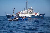 Sea Watch-2.<br /> Die Sea Watch-2 bei ihrer 13. SAR-Mission vor der libyschen Kueste.<br /> Im Bild: Ein Schlauchboot mit ca. 160 Menschen wird von der Sea Watch-Crew mit Rettungswesten versorgt.<br /> Im Hintergrund die Sea Watch-2.<br /> 20.10.2016, Mediterranean Sea<br /> Copyright: Christian-Ditsch.de<br /> [Inhaltsveraendernde Manipulation des Fotos nur nach ausdruecklicher Genehmigung des Fotografen. Vereinbarungen ueber Abtretung von Persoenlichkeitsrechten/Model Release der abgebildeten Person/Personen liegen nicht vor. NO MODEL RELEASE! Nur fuer Redaktionelle Zwecke. Don't publish without copyright Christian-Ditsch.de, Veroeffentlichung nur mit Fotografennennung, sowie gegen Honorar, MwSt. und Beleg. Konto: I N G - D i B a, IBAN DE58500105175400192269, BIC INGDDEFFXXX, Kontakt: post@christian-ditsch.de<br /> Bei der Bearbeitung der Dateiinformationen darf die Urheberkennzeichnung in den EXIF- und  IPTC-Daten nicht entfernt werden, diese sind in digitalen Medien nach §95c UrhG rechtlich geschuetzt. Der Urhebervermerk wird gemaess §13 UrhG verlangt.]