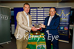 Kevin McCarthy makes a presentation to Tim Murphy (Chairman Kerry GAA) in recognition of the work of the Kerry GAA in the community during Covid at the Kerry GAA Senior championship draw in Austin Stack Park on Monday.