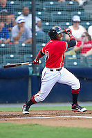 Francisco Peguero #49 of the Richmond Flying Squirrels follows through on his swing against the Harrisburg Senators in game one of a double-header at The Diamond on July 22, 2011 in Richmond, Virginia.  The Squirrels defeated the Senators 3-1.   (Brian Westerholt / Four Seam Images)