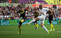 Fernando Llorente of Swansea City (R) scores a goal while marked by John Stones of Manchester City making the score 1-1 during the Premier League match between Swansea City and Manchester City at The Liberty Stadium in Swansea, Wales, UK. Saturday 24 September 2016