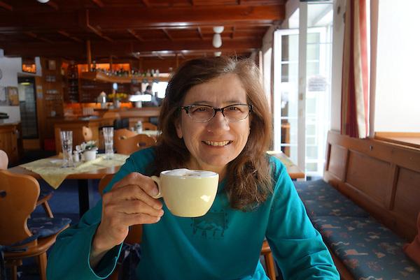 Beth having coffee in Stuben restaurant, St Anton, Austria,