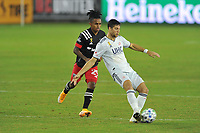 WASHINGTON, DC - SEPTEMBER 27: Matt Polster #8 of New England Revolution battles for the ball with Yordi Reyna #29 of D.C. United during a game between New England Revolution and D.C. United at Audi Field on September 27, 2020 in Washington, DC.
