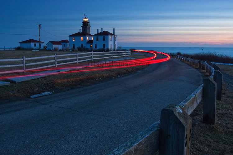 The glow of taillights leaving Beavertail at dusk.