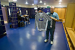 Queen's Park 1 Alloa Athletic 0, 01/12/2007. Hampden Park, Scottish League Two. A member of the backroom staff of Queen's Park putting out the home team's strips prior to their fixture against Alloa Athletic in a Scottish League second division match at Hampden Park, Glasgow. The home team won by one goal to nil with a goal by Alan Trouten in the 88th minute. Queen's Park, founded in1867, are currently trying to become only the third FIFA Order of Merit club after Real Madrid and Sheffield FC. Photo by Colin McPherson.