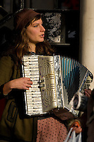 A street musician plays the accordion in Seattle Washington.