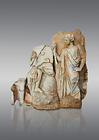 Roman Sebasteion relief  sculpture of Apollo and a Muse Aphrodisias Museum, Aphrodisias, Turkey. <br /> <br /> On the left stood Apollo, one foot raised on a rock, playing his lyre which rests on top of the omphalos (the earth's navel stone, tied down at Delphi(. On the right stands a muse holding one arm of Apollos lyre.