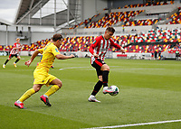 6th September 2020; Brentford Community Stadium, London, England; English Football League Cup, Carabao Cup, Football, Brentford FC versus Wycombe Wanderers; Sergi Canos of Brentford being marked by Dominic Gape of Wycombe Wanderers