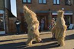 Straw Bear Festival. Whittlesea Whittlesey Cambridgeshire UK 2008. Straw Bear. Children Bear behind the procession around the town.