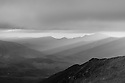Dawn brings a threatening sky on this cold november morning. Looking out over the Pemigewasset Wilderness from Franconia Ridge.