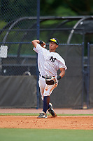 GCL Yankees East third baseman Javier Reynoso (14) throws to first base during a Gulf Coast League game against the GCL Phillies West on July 26, 2019 at the New York Yankees Minor League Complex in Tampa, Florida.  (Mike Janes/Four Seam Images)