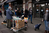 April 18, 2020<br /> Brooklyn, New York<br /> Atlantic Center<br /> <br /> People purchase gloves and masks just outside the Atlantic terminal in Brooklyn.
