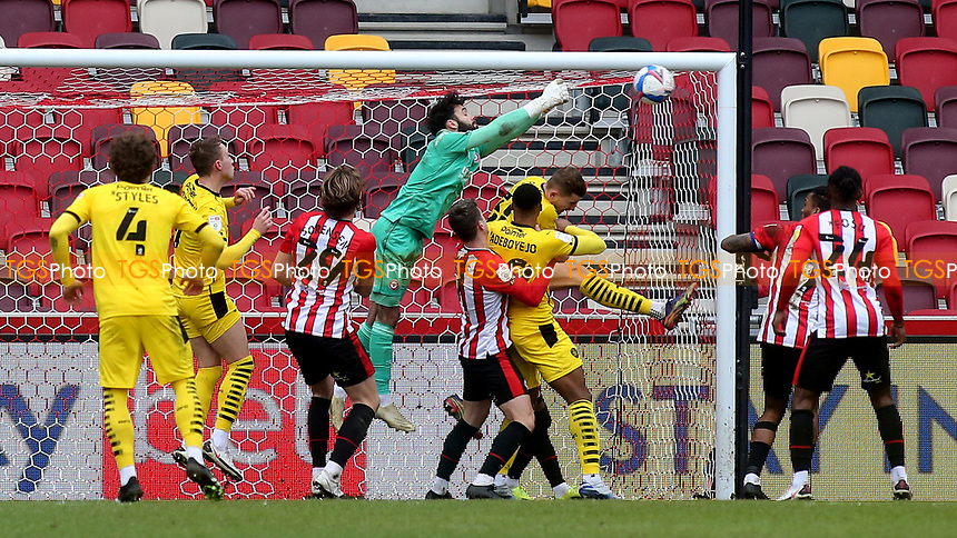 Brentford goalkeeper, David Raya, punches the ball clear during Brentford vs Barnsley, Sky Bet EFL Championship Football at the Brentford Community Stadium on 14th February 2021