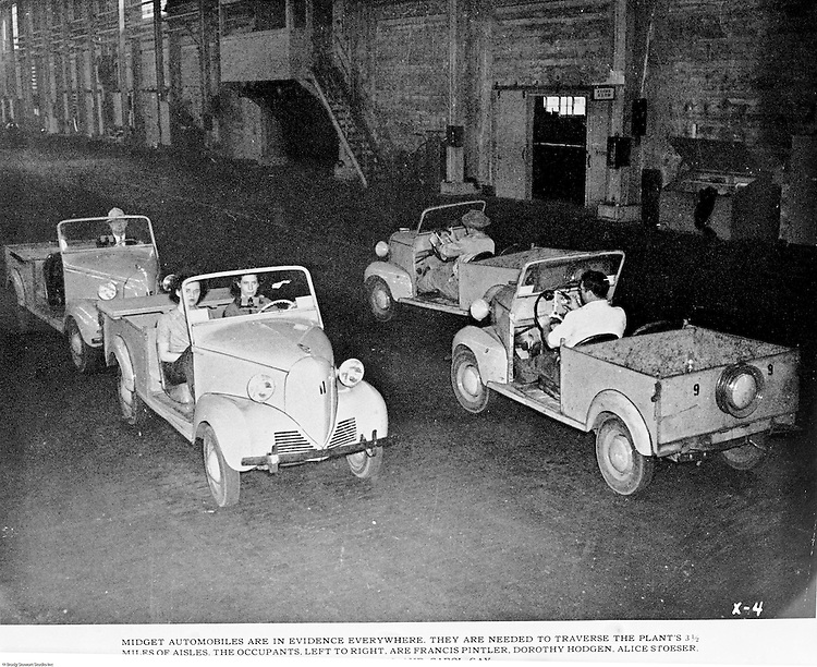 Spokane Washington and McCook Illinois: View of Swindell-Dressler brochure highlighting the Electric Furnaces designed, constructed, and installed in two Alcoa plants during World War II. The caption reads:  Midget automobiles are in evidence everywhere.  They are needed to traverse the plant's 3 ½ miles of aisles.  The occupants in the two cars facing us are, left to right, Francis Pintler, Dorothy Hodgon, and Alice Stoeser.