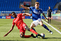 Joe Ralls of Cardiff City (R) takes a cross while closely follwoed by Sammy Ameobi of Nottingham Forest (L) during the Sky Bet Championship match between Cardiff City and Nottingham Forest at the Cardiff City Stadium, Cardiff, Wales, UK. Friday 02 April 2021