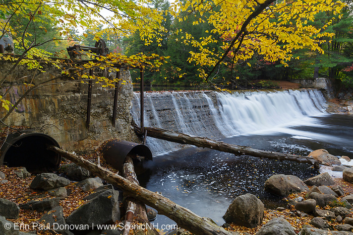 Parker's Dam along the Pemigewasset River in North Woodstock, New Hampshire during the autumn months. This is the site of an old mill dating back to the logging era.