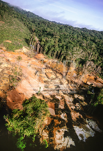 Roraima State, Brazil. High view of a illegal garimpeiro panning gold mine; the water is polluted with mercury used to extract the gold from the ore.