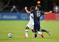 LAKE BUENA VISTA, FL - AUGUST 01: Yimmi Chará #23 of the Portland Timbers is pressured by Jesús Medina #19 of New York City FC during a game between Portland Timbers and New York City FC at ESPN Wide World of Sports on August 01, 2020 in Lake Buena Vista, Florida.