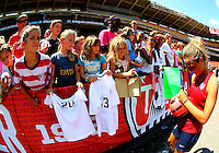 WASHINGTON D.C. - September 02, 2013:<br /> Kristie Mewis  signs autograophs During a USA WNT open practice at RFK Stadium, in Washington D.C. the day before the USA v Mexico international friendly match.