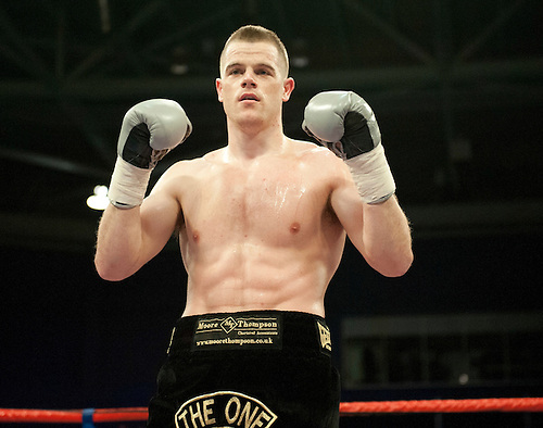 GLASGOW, SCOTLAND - MARCH 10: Callum Johnson (black shorts) celebrates stopping Tommy Tolan during their Light-Heavyweight contest on the Ricky Burns undercard at the Braehead Arena on March 10, 2012 in Glasgow, Scotland. (Photo by Rob Casey/Getty Images)