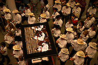 Trainers created a sea of hats as they gathered at the National Cowgirl Hall of Fame for a pre-competition event. Extreme Mustang Makeover featured100 Trainers, 100 Mustangs, 100 Days  for a competition that awarded a $25,000 prize to the winner.  <br /> <br /> Mustang Heritage Foundation and the Bureau of Land Management created the competition to raise awareness of the value of mustangs, and to showcase the beauty, versatility, and trainability of these rugged horses.  <br /> <br /> In an amazing display of horsemanship that included cracking whips, shooting balloons and a chain saw, 12 trainers faced off in the finals.  Veteran cutting horse trainer Guy Woods won the competition with  Kitty Lauman placing second.<br /> An adoption followed the event where one horse brought $58,000 and could have been bought for $125 from the BLM.  The 75 mustangs that made it through the event were adopted for a total of $233,100.