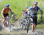 Brendon Carney (9) and Caitlin Holmes carry their bikes across the first ford as Simon Bloomberg (233) enters the water.Mammoth Adventure MTB Ride, Nelson<br /> Photo: Marc Palmano/shuttersport.co.nz