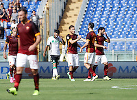 Calcio, Serie A: Roma vs Sassuolo. Roma, stadio Olimpico, 20 settembre 2015.<br /> Roma's Francesco Totti, third from right right, celebrates with teammates after scoring during the Italian Serie A football match between Roma and Sassuolo at Rome's Olympic stadium, 20 September 2015.<br /> UPDATE IMAGES PRESS/Isabella Bonotto