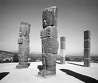 Toltec statues. Two of the 4 female warriors known as The Atlanteans, and the 2 posts behind them which represent supporting males. Remnants of the Toltec Empire in Tula, Mexico. Tula, Hidalgo, Mexico.