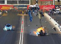 Feb 25, 2018; Chandler, AZ, USA; NHRA funny car driver John Force explodes the body off his car on fire alongside Jonnie Lindberg during the Arizona Nationals at Wild Horse Pass Motorsports Park. Mandatory Credit: Mark J. Rebilas-USA TODAY Sports