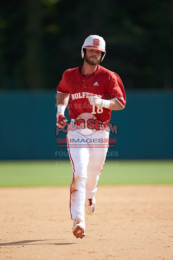 Evan Edwards (18) of the North Carolina State Wolfpack rounds the bases after hitting a home run against the Army Black Knights at Doak Field at Dail Park on June 3, 2018 in Raleigh, North Carolina. The Wolfpack defeated the Black Knights 11-1. (Brian Westerholt/Four Seam Images)