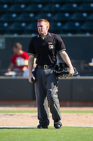 Home plate umpire Chase Eade between innings of the Carolina League game between the Wilmington Blue Rocks and the Winston-Salem Dash at BB&T Ballpark on July 6, 2014 in Winston-Salem, North Carolina.  The Dash defeated the Blue Rocks 7-1.   (Brian Westerholt/Four Seam Images)