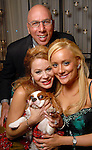Erica Rose with her parents Dr. Franklin Rose and Cindi Rose and her dog Shayna at the 23rd Annual Celebrity Paws Gala benefitting Citizens for Animal Protection's Shelter and Pet Adoption Center at the Hilton Americas Hotel Saturday Nov. 21,2009. (Dave Rossman/For the Chronicle)