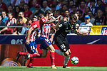Franco Vazquez (r) of Sevilla FC fights for the ball with Sime Vrsaljko and Gabriel Fernandez Arenas, Gabi, of Atletico de Madrid during the La Liga 2017-18 match between Atletico de Madrid and Sevilla FC at the Wanda Metropolitano on 23 September 2017 in Wanda Metropolitano, Madrid, Spain. Photo by Diego Gonzalez / Power Sport Images