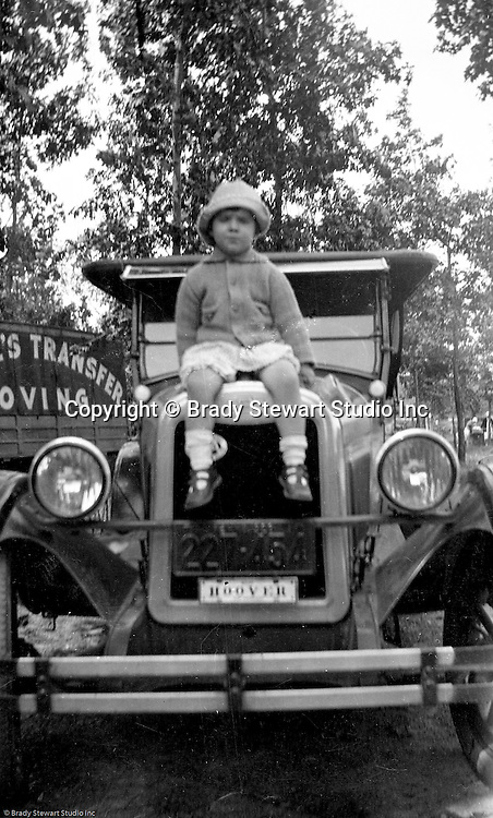 East Brady PA:  Sally posing for a photo on the hood of dad's car.  Stewart's were traveling in their 1926 Chevrolet Touring Car.  The route took them from Wilkinsburg to Brady's Bend via Rt 28. This vacation was different from many of the others.  Instead of vacationing near North East PA, they decided to vacation on Presque Isle on Lake Erie.  Brady Jr, Sarah, and Sally in photo