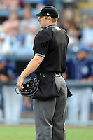 Home plate umpire Brian Peterson during a game against the Augusta GreenJackets and the Asheville Tourists at McCormick Field on June 27, 2013 in Asheville, North Carolina. The Tourists won the game 10-6. (Tony Farlow/Four Seam Images)