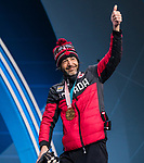 Brian McKeever, PyeongChang 2018 - Para Nordic Skiing // Ski paranordique.<br /> Brian McKeever and his guide Graham Nishikawa collect their gold medals in the men's 20km free visually impaired cross country event // Brian McKeever et son guide Graham Nishikawa remportent leur médaille d'or dans l'épreuve de cross-country libre avec un défiance visuelle du 20 km masculin. 12/03/2018.