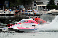 """13-14 June, 2009, APBA Inboards, Walled Lake, Novi, MI. USA.Becky Wilson, T-31 """"Miss Circus Circus"""", 1 Litre Stock hydroplane.©F. Peirce Williams 2009 USA.F.Peirce Williams.photography.ref: RAW (.NEF) File Available"""