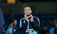 Goal scorer Michael Harriman of Wycombe Wanderers applauds the supporters during the Sky Bet League 2 match between Wycombe Wanderers and Notts County at Adams Park, High Wycombe, England on 15 December 2015. Photo by Andy Rowland.