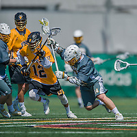 16 April 2016: University of Vermont Catamount Midfielder Connor Van Ryn, a Sophomore from Whitby, Ontario, battles UMBC Defender/Long Stick Midfielder Kennedy Solomon, a Freshman from Ladera Ranch, CA, during game action against the University of Maryland, Baltimore County Retrievers at Virtue Field in Burlington, Vermont. The Catamounts defeated the Retrievers 14-10 in NCAA Division I play. Mandatory Credit: Ed Wolfstein Photo *** RAW (NEF) Image File Available ***