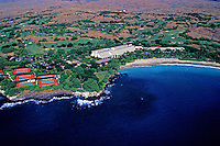 Aerial shot of the luxurious Mauna Kea Beach Hotel and coastline on the Big Island of Hawaii.