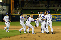 Round Rock Express players lift shortstop Luis Hernandez as they celebrate a walk off win in the Pacific Coast League against the Las Vegas 51s on August 7th, 2012 at the Dell Diamond in Round Rock, Texas. Hernandez delivered the game winning hit in the bottom of the ninth inning as the Express defeated the 51s 5-4. (Andrew Woolley/Four Seam Images).