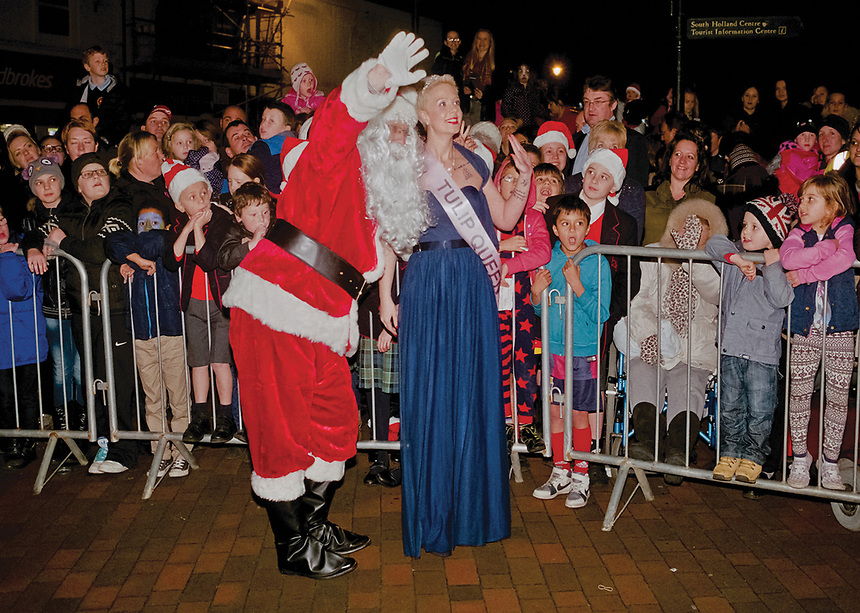 """Queen of Tulip Radio 107.5, ambassador for South Holland Amy Cook accompanies Santa Claus as they are greeted by well-wishers.<br /> <br /> """"At one point in the search for Tulip Radio Tulip Queen, it almost seemed as if the young women of the district had turned their backs on the tradition of representing the areaís floral heritage."""""""