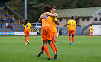 Luke O'Nien of Wycombe Wanderers congratulates goal scorer Sido Jombati of Wycombe Wanderers during the FA Cup 1st Round match between FC Halifax Town and Wycombe Wanderers at The Shay Stadium, Shaw Hill, Halifax, West Yorkshire, England on 8 November 2015. Photo by Andy Rowland.