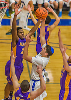 22 November 2015: Yeshiva University Maccabee Forward Shelby Rosenberg, a Senior from Woodmere, NY, is heavily defended as he makes a shot in the second half of NCAA Men's Basketball play against the Hunter College Hawks at the Max Stern Athletic Center  in New York, NY. The Maccabees defeated the Hawks 81-71 in non-conference play, for their second win of the season. Mandatory Credit: Ed Wolfstein Photo *** RAW (NEF) Image File Available ***