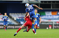 Paul Kalambayi of AFC Wimbledon and Ryan Cassidy of Accrington Stanley go for a header during AFC Wimbledon vs Accrington Stanley, Sky Bet EFL League 1 Football at The Kiyan Prince Foundation Stadium on 3rd October 2020
