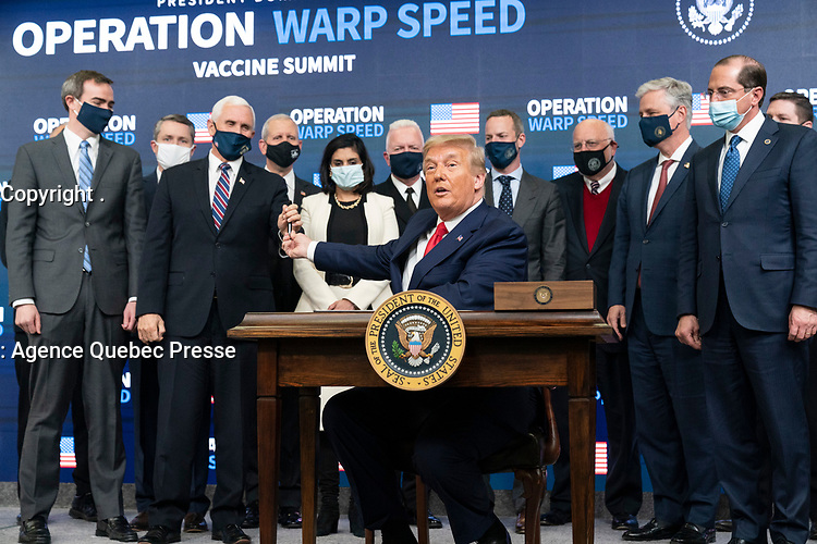 Operation Warp Speed Vaccine Event<br /> <br /> President Donald J. Trump, joined by Vice President Mike Pence and senior White House staff, displays his signature after signing an Executive Order ensuring that the American people have priority access to COVID-19 vaccines developed in the U.S. or procured by the U.S. Government, at the Operation Warp Speed Vaccine Summit Tuesday, Dec. 8, 2020, in the South Court Auditorium at the Eisenhower Executive Office Building at the White House. (Official White House Photo by Shealah Craighead)