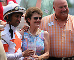 June 28, 2014:  Two year old colt Cinco Charlie (Indian Charlie x Ten Halos, by Marquetry) wins the G3 Bashford Manor Stakes at Churchill Downs with jockey Shaun Bridgmohan.  The owners and jockey pose with the trophy in the winner's circle. Trainer Steve Asmussen, owners Corinne and L. William Heiligbrodt. Breeder Candyland Farm.  ©Mary M. Meek/ESW/CSM