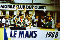 12.06.1988. Le Mans 24 Hours. The winning Tom Walkinshaw Racing Jaguar team of Jan Lammers, Johnny Dumfries and Andy Wallace celebrate on the podium. Dumfries, real name John Colum Crichton-Stuart, 7th Marquis of Bute, passed away on 22nd March 2021 after a brief illness