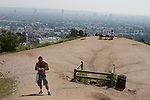 People working out at Runyon Canyon Park with a view over Hollywood, CA